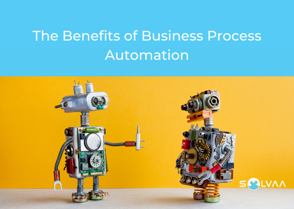 Two toy metal robots talking to each other with a yellow background and blue overlay with white text which says 'The Benefits of Business Process Automation'.