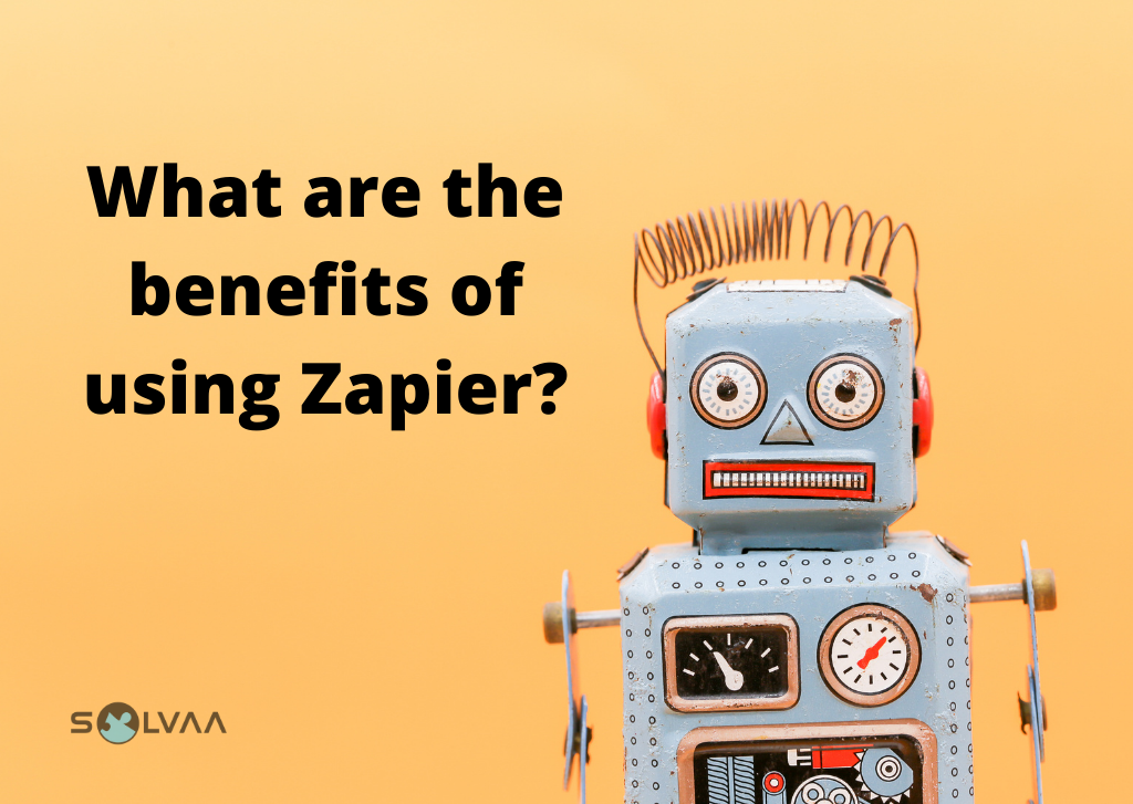 "Toy robot on an orange background with the text ""What are the benefits of using Zapier"" in black along with a Solvaa logo."