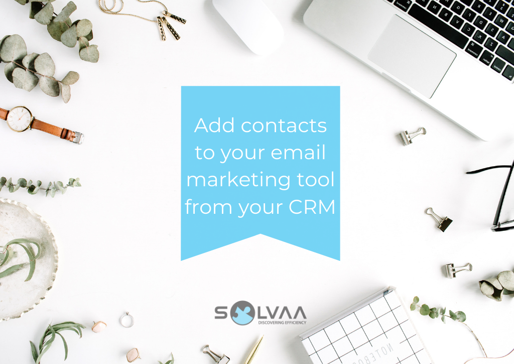 "Image showing a flatlay laptop with bulldog clips on a white background with overlaid text in a blue section which says ""Add contacts to your email marketing tool from your CRM""."