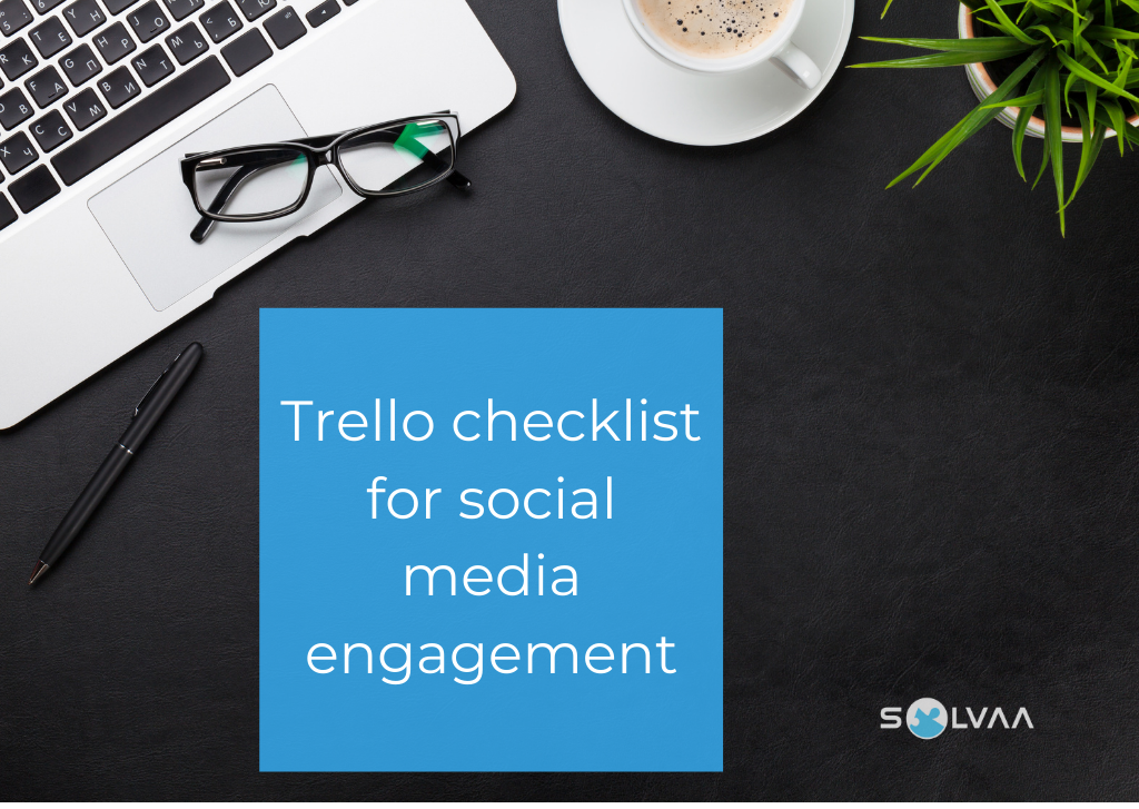 Flatlay of a macbook, glasses, coffee and plant on a dark desk with overlaid text saying 'Trello checklist for social media engagement'.