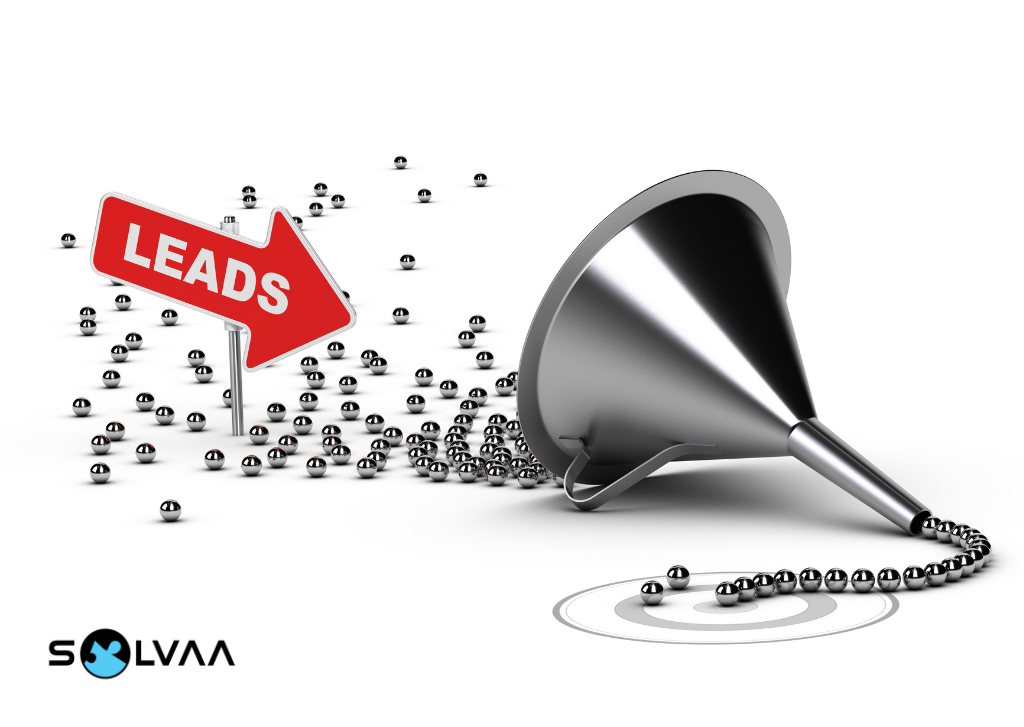 Concept of a sales funnel featuring small silver balls feeding into a metal funnel with a neat row coming out the other side. A red sign is pointing at the funnel which reads 'Leads'.
